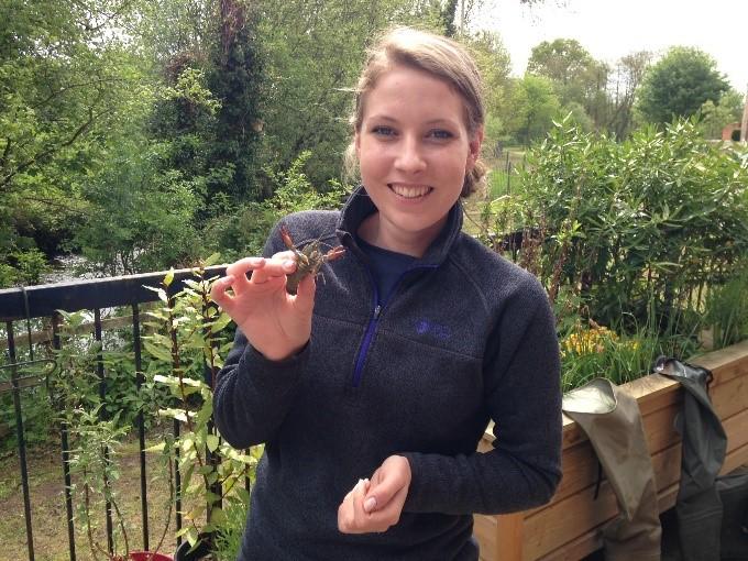Sarah holding a signal crayfish