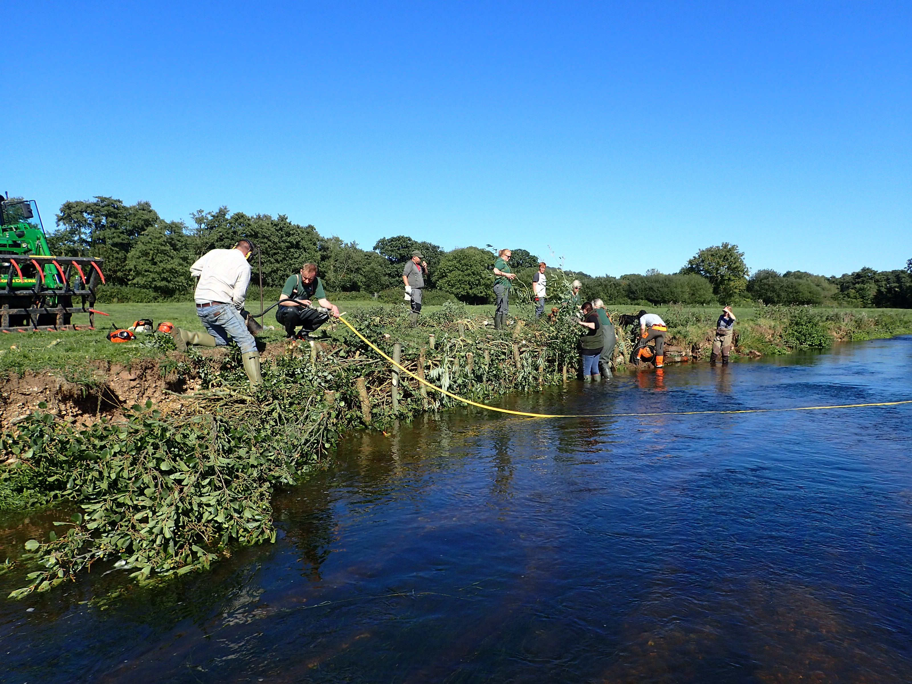 Volunteers repairing an eroded bank on the River Culm