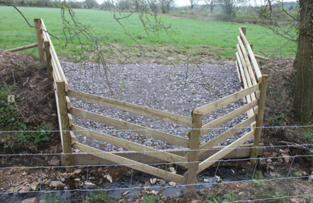 Cattle drinking point made with stone